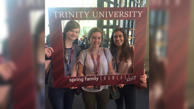 Trinity U students with frame at Spring Family Showcase