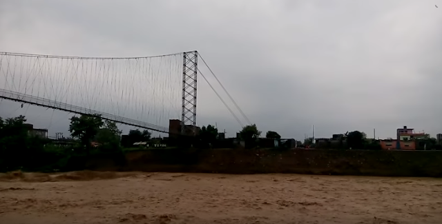 The flooded Tinau River washed away a suspension bridge at the Nepalese border town of Butwal on Tuesday.  The dramatic collapse of the bridge, one of the longest in Nepal,  was caught on a mobile camera by an onlooker.  The footage also has the audio of people shouting to warn those on the other side of the bank about the imminent collapse.