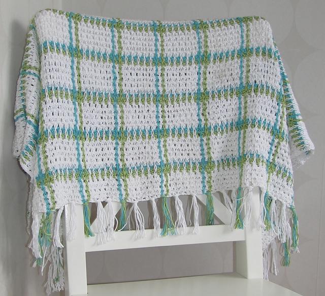 Manta con Cadenetas de Crochet por encima del punto