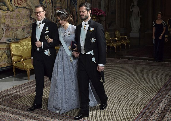 Queen Silvia, Prince Daniel, Prince Carl Philip. Princess Sofia wore Ida Sjöstedt gown from Fall Winter collection