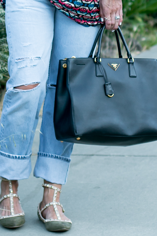 cuffed light denim levis with studded rocketed flats