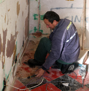 Bekir fixing up the wiring for the plug sockets