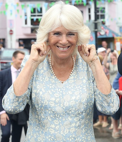 The Duchess of Cornwall wears a pale blue floral midi dress for the visit. Prince Charles, Prince Willaim, Prince Harry, Meghan Markle, kate Middleton