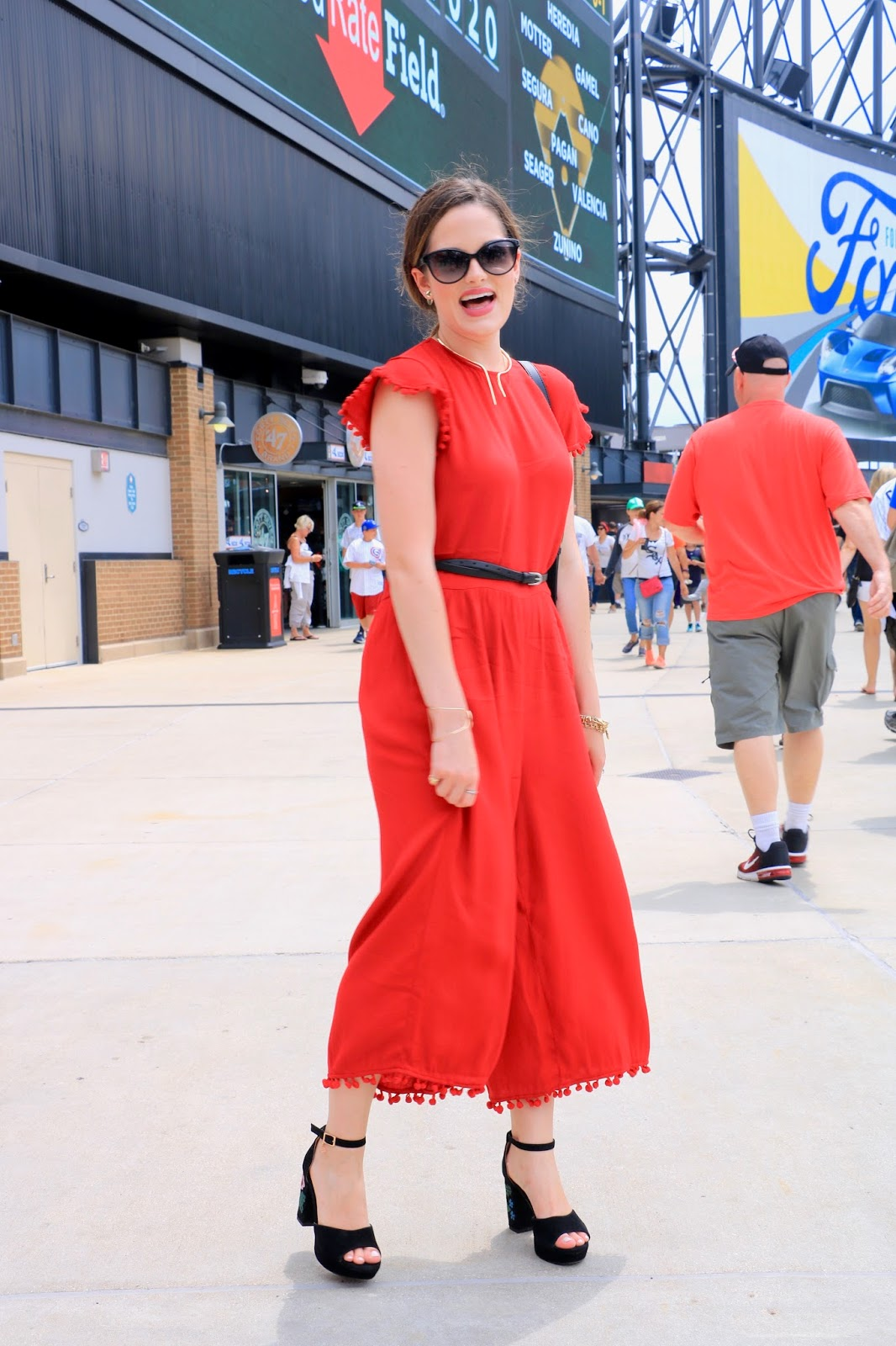 Fashion blogger Kathleen Harper wearing red jumpsuit fall