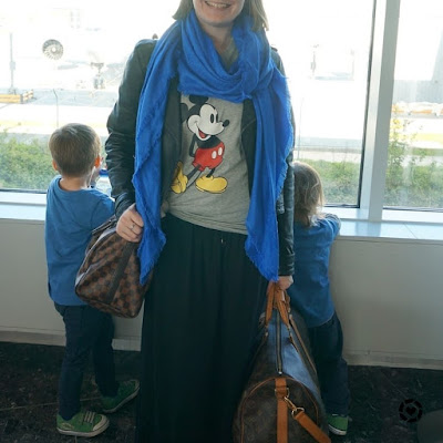 awayfromblue Instagram | travel style flight to Paris Mickey Mouse tee maxi skirt leather jacket Louis Vuitton luggage