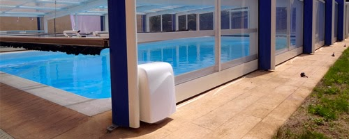 les motorisations pour abri de piscine. Black Bedroom Furniture Sets. Home Design Ideas