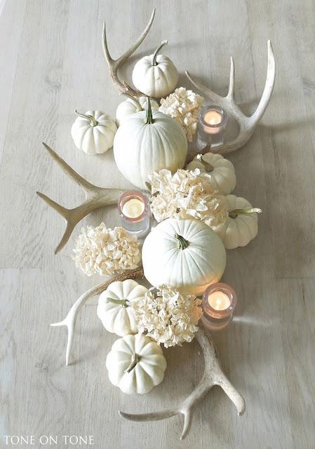 antlers centrepiece, white hydrangeas, white pumpkins, bleached wood