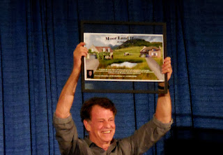 John Noble holds up the prize for the charity auction at Shore Leave 38, Hunt Valley, MD.