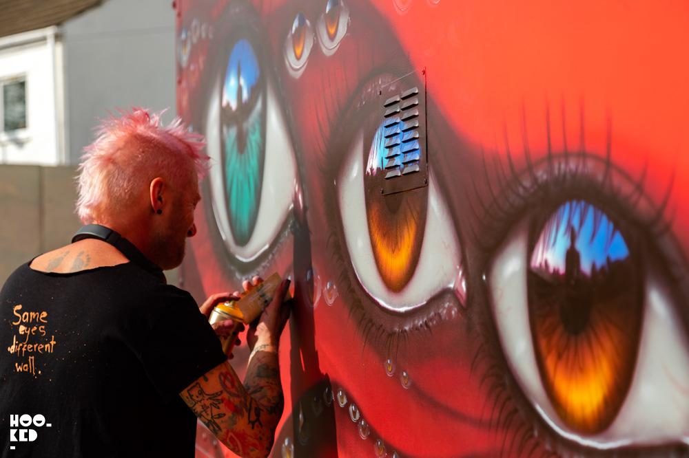 Street Artist My Dog Sighs painting a truck with spray paint