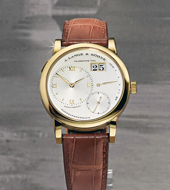 The first Lange 1: champagne dial with case, hands and hours markers in yellow gold