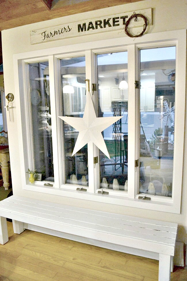 bench under large window with a star