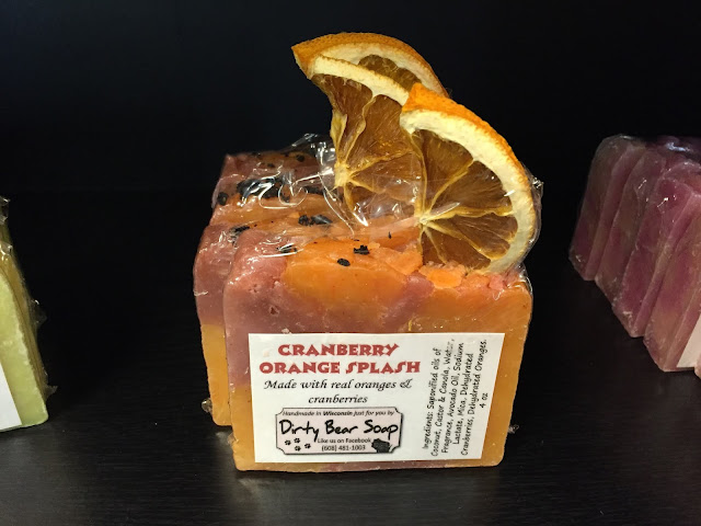 One of many varieties of Dirty Bear Soap -- this bar is made with REAL oranges and cranberries!