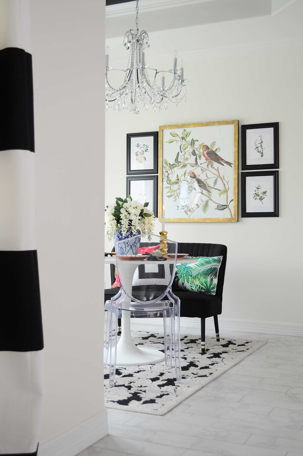 A $100 dining room makeover with black, white and gold decor and audubon accents. Lots of great ideas on how to decorate a home on a budget and make an impact. | #diningroom #diningroomdecor #smallspace #diningnook #breakfastnook #blackandwhite #chandelier #audubon #botanicals #botanical #budgetdecor #interiordesign