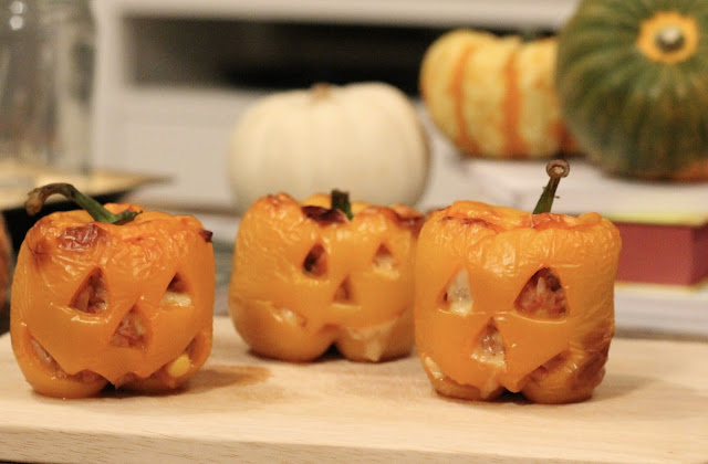 Trying recipes I found on Pinterest - Chicken and Rice Stuffed Pumpkin Peppers - Halloween themed