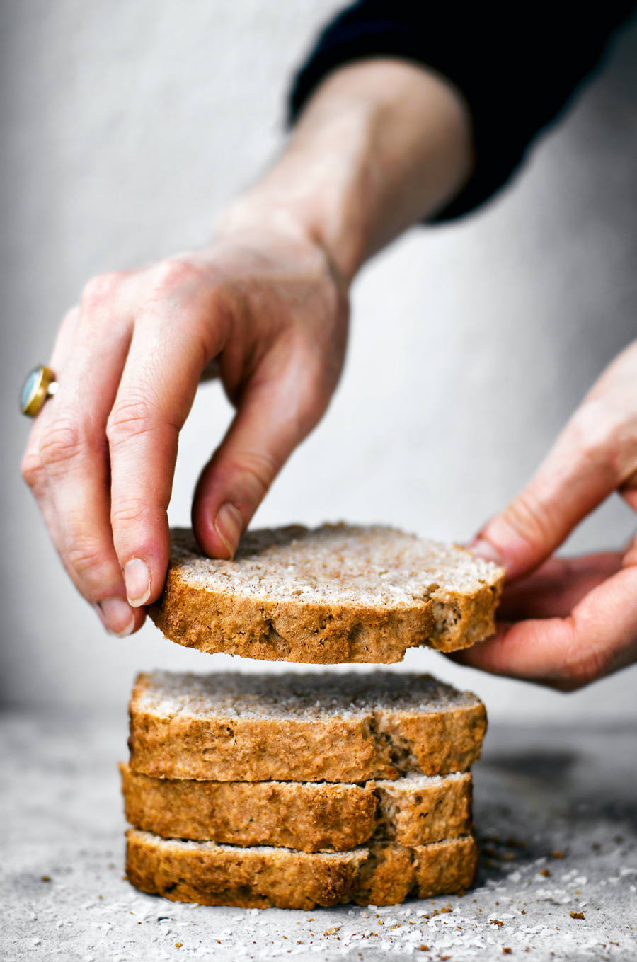 Vegan coconut bread made with shredded coconut, coconut oil, and coconut milk - that's the triple bit! This is a healthy twist on the classic, with just a little maple syrup as sweetener and made with whole wheat spelt flour.