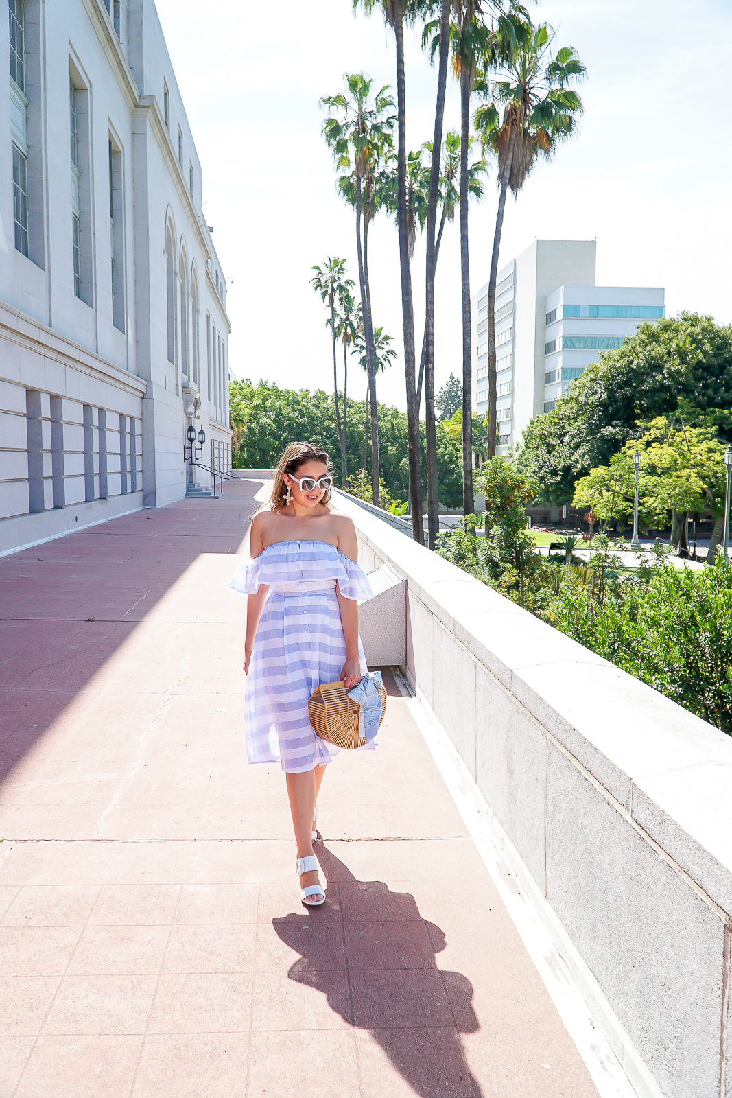Lulus Blue and Ivory striped midi dress, Lulus off the shoulder Midi dress, Top 4 Trends of Summer, Stuart Weitzman City Sandals, Stuart Weitzman White Sandals, Kate Spade Krystalyn White Sunglasses, Cult Gaia Ark Bag, Bamboo summer bag, Cross Earrings, Louis Vuitton Blue Trunks Bandeau