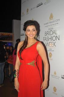 Kajal Agarwal New Stills In Orange Dress