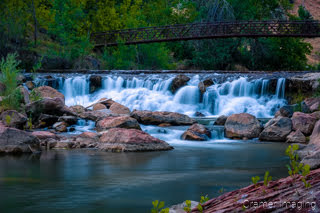 Cramer Imaging's fine art landscape photograph of a waterfall and bridge on the Virgin River in Zion National Park Utah