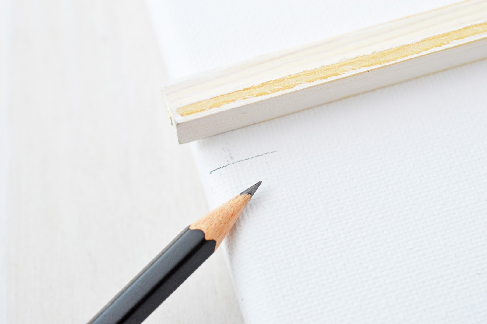 marking a canvas for a DIY letter board