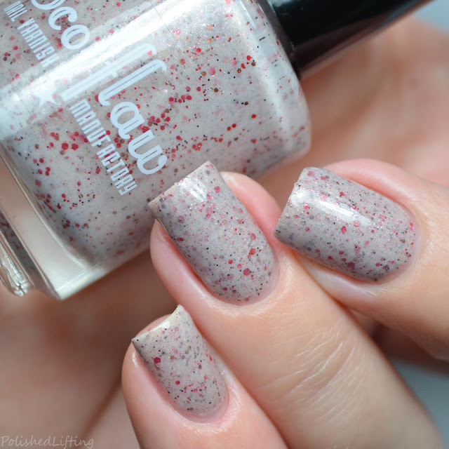 beige nail polish with red glitter