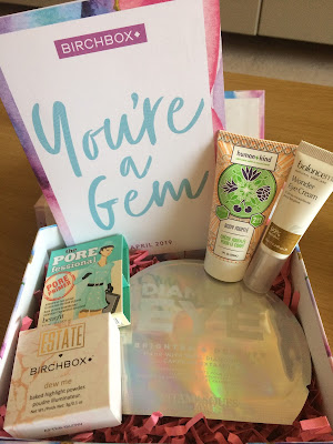 Card reading 'Your a gem' and a selection of five beauty products laid out inside a box