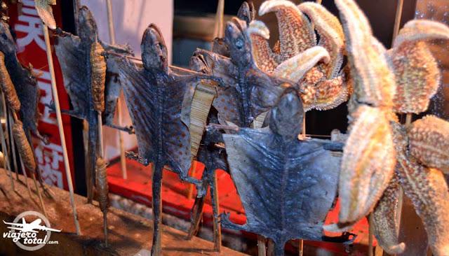 Brochetas chinas de lagartos voladores