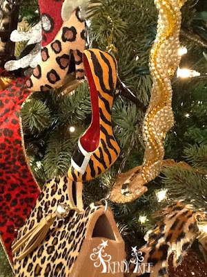 http://www.trendytree.com/raz-christmas-and-halloween-decor/raz-animal-print-high-heel-ornaments-set-of-4-christmas-catwalk-collection-christmas-decoration.html