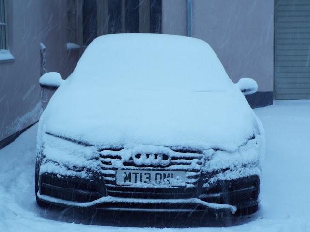 audi A7 snow stuck sports car blog