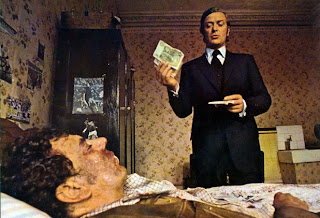 Michael Caine as Jack Carter, pays off the bar tender for his damages, Get Carter, Directed by Mike Hodges