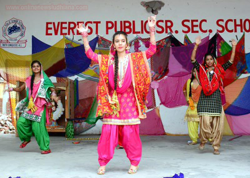 Students performs on stage during Teej Festival celebrations at Everest School