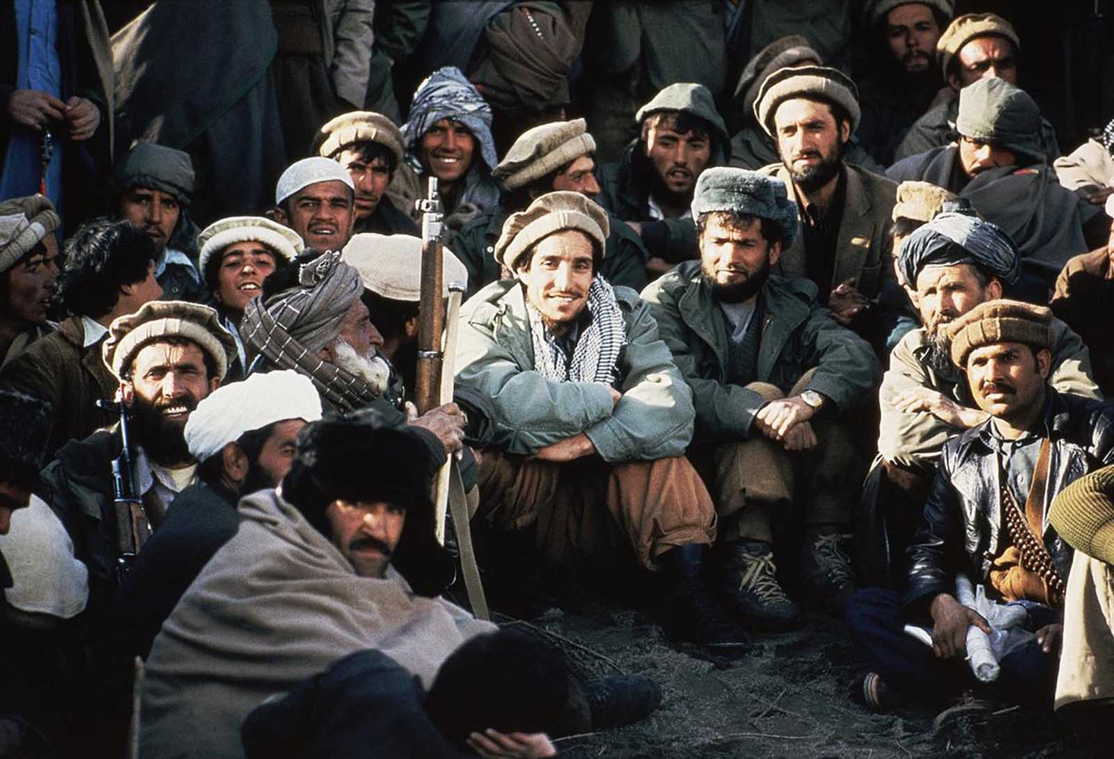 Afghan guerrilla leader, Ahmad Shah Massoud, center, is surrounded by Mujahideen commanders at a meeting of the rebels in the Panchir Valley in northeast Afghanistan in 1984. Massoud was central to much of the ant-Soviet resistance, and after the troops left, struggled with others to create a new government. In a few years, Massoud and his forces were fighting the Taliban, and he had become an enemy of Osama bin Laden. On September 9, 2001 Massoud was assassinated by two attackers backed by Al Qaeda, just days before the September 11 attacks on the U.S.