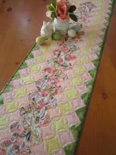https://www.patchworkmountain.com/collections/table-runners/products/spring-quilted-table-runner-1