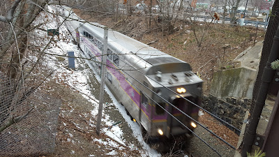 MBTA commuter train passes under the Main St bridge coming into Franklin/Dean Station