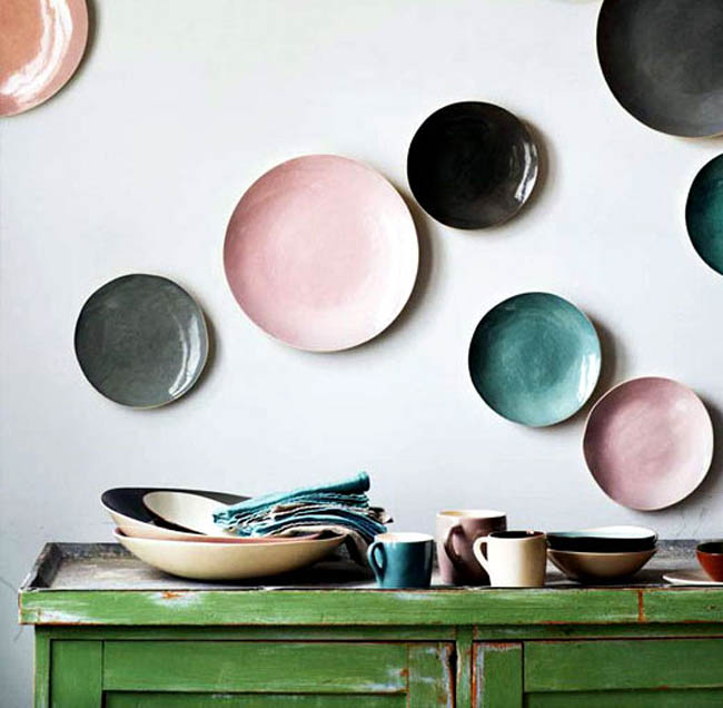 Beautiful Pastel Colored Plates Displayed on the Wall