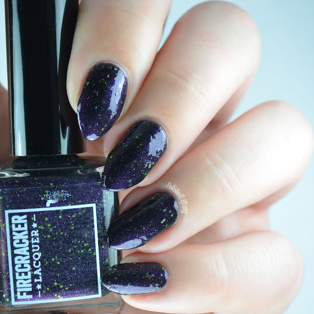 purple shimmer nail polish with green glitter