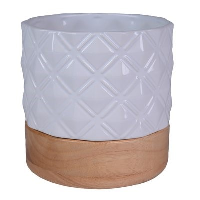 White ceramic planter with wood base