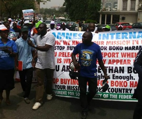 "BREAKING: ""Leave Nigeria"" Protest Rocks Amnesty International Office In Abuja"