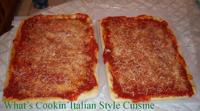 Tomato Pie Recipe from Upstate Utica New York is a pizza dough that is risen high, cooked with tomato sauce and grated cheese without mozzarella. It is well known in Utica, Rome and in the upstate new york area. It is like a bread with sauce and romano cheese on it