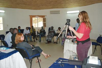 Venice Arts trainer, Brigid McCaffrey, demonstrates how to use the tripod.