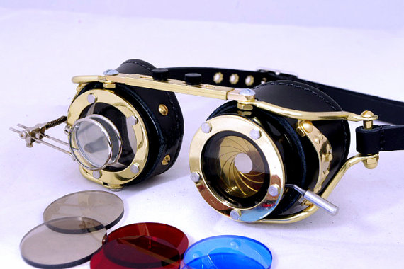 Steampunk goggles with magnifying lenses (dual magnifiers) and camera aperture shutter lens made of brass. Made of steel brass and leather