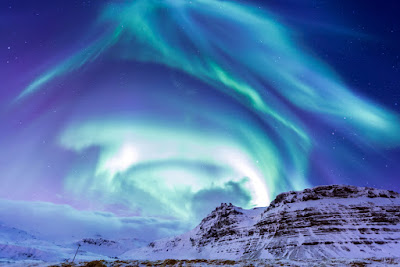 Iceland's Kirkjufell mountain is one of the best places to see Iceland's Northern Lights
