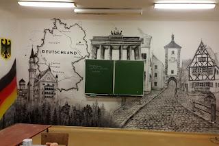 Malowanie malowidła ściennego w sali języka niemieckiego, mural ścienny Warszawa, toruń, artystyczne malowanie ścian