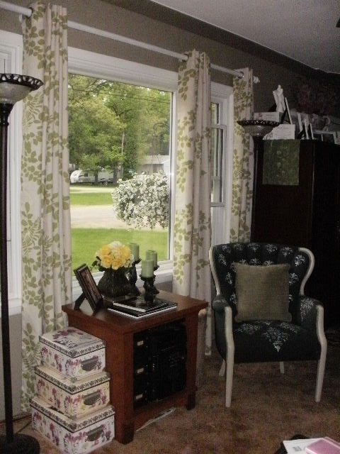 Reveal of the green and creamy beige curtains with a leaf pattern