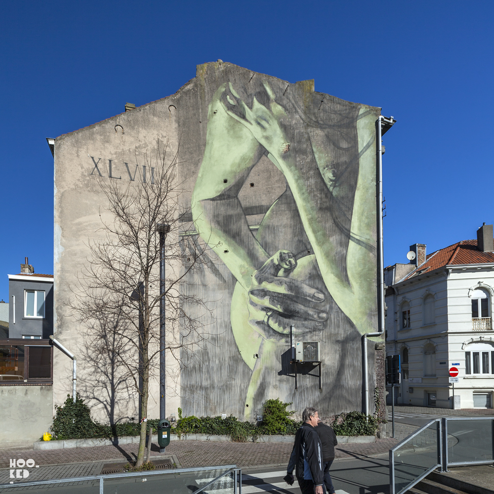 Female figure painted on wall by artist Faith47 in Ostend