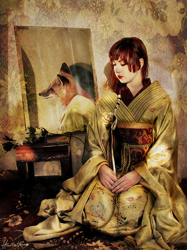 Kitsune as a beautiful Japanese woman, but her mirror reflects the image of a fox