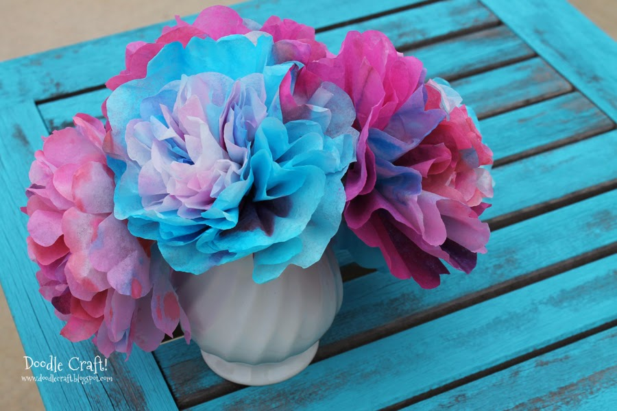 Make coffee filter flowers by dying them with food coloring and combining them together to make fluffy flowers.