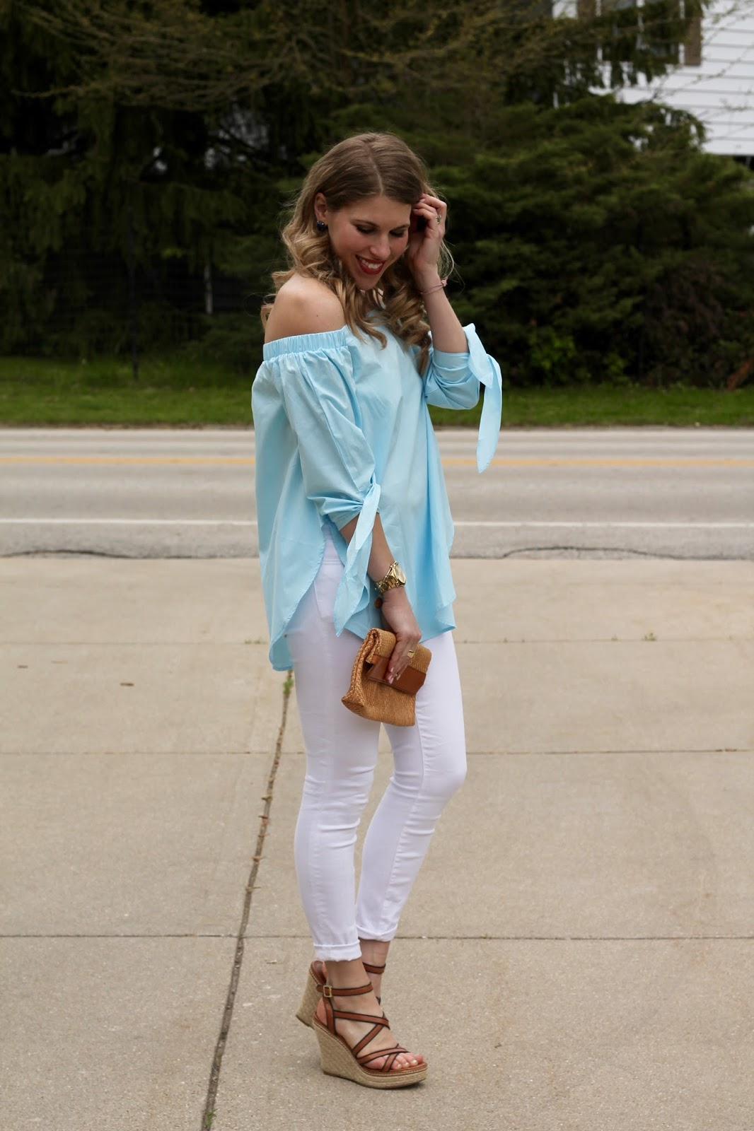 light blue off the shoulder top, white skinny jeans, wedge sandals, straw clutch