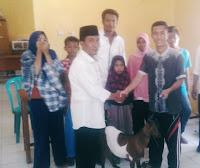 Penghujung Jabatan, Kades Risa Serahkan Bantuan 31 ekor Kambing untuk Warga Miskin