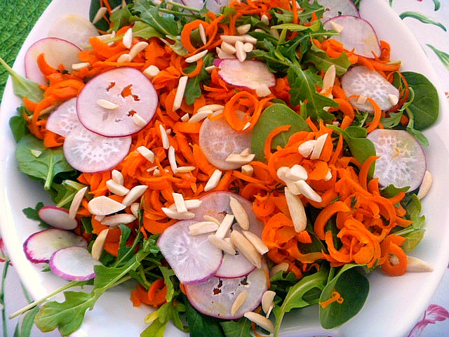 Roasted Carrot Noodle Salad with Honey Thyme Vinaigrette:  Wonderfully sweet and tender roasted carrots sit atop a bed of arugula, mixed with thin sliced Easter egg radishes, and doused with a honey thyme vinaigrette.. Slice of Southern