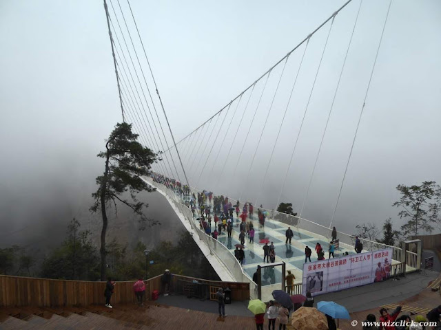 Zhangjiajie Grand Canyon Glass bridge in in rainy and misty weather view from amphitheater end of the bridge.